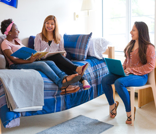 Female students in dorm room mobile image